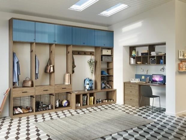 Light Brown and Blue Themed Room with Built in Desk Shelving Cubbies and Baskets
