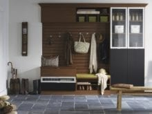 Dark Brown and Black Entrance Way Storage with Cubbies Cabinets Coat Hangers Display Shelves with Glass Doors and White Trim