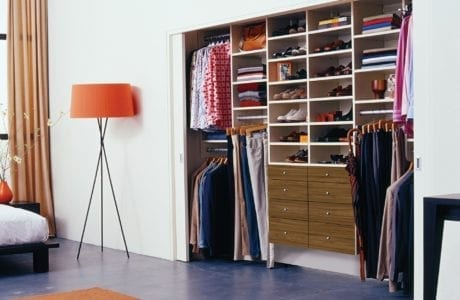 Reach in Closet with Closet Rods and Brown Drawers and White Shelving