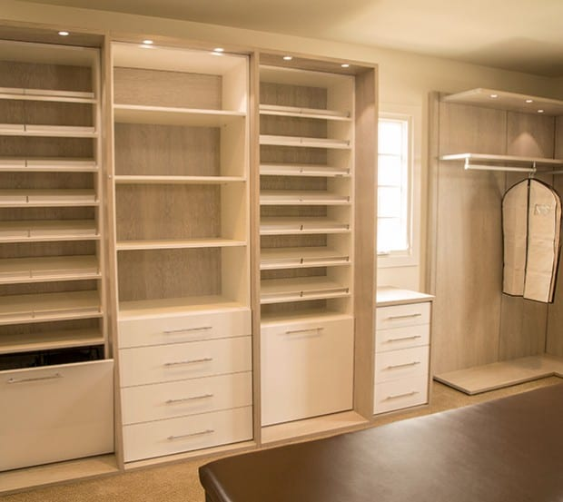 Walk in Closet Design with Tan Display Shelving and White Closet Rods and Drawers