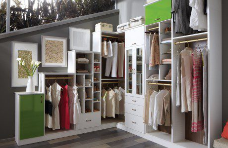 White Themed Walk in Closet With Drawers Shelves Closet Rods and Apple Green Accent Cabinets