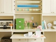 Eggshell White Craft Room with Cabinets Paper Racks and Workspace