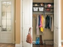Reach in Closet With Grey Shelving and Metal Closet Rods