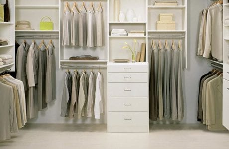 White Themed Walk in Closet with Drawers Shelving and Metal Closet Rods