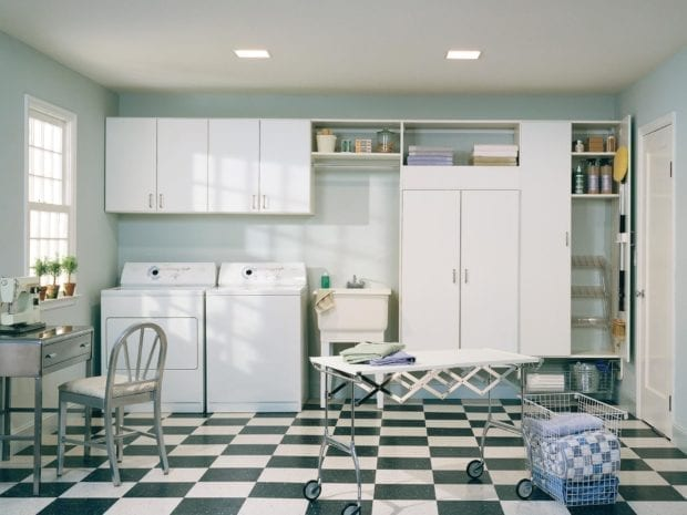 White Themed Laundry Room with Shelving Cabinets and Storage Closet