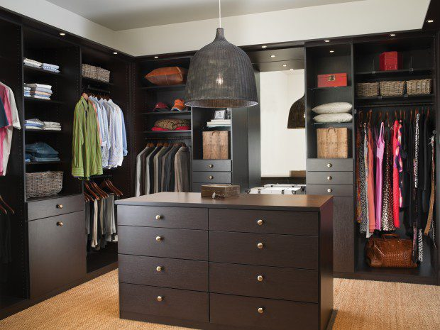 Dark Brown Walk in Closet with Cabinets Shelves Vanity Mirror and Built in Lighting