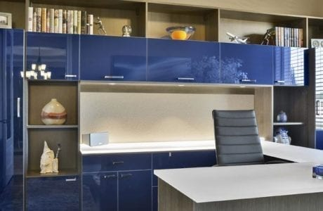 Office with High Gloss Dark Blue Cabinets High Gloss White topped Desk Wood Grain Grey Display Shelves and Built in Lighting