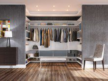 White Backed Walk in Closet with White Stand Alone Bench Closet Rods Shelving and Grey Cabinets