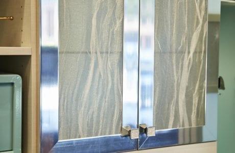 Decorative Wood Grain Cabinet Doors with Aluminum Trim and Gold Handles