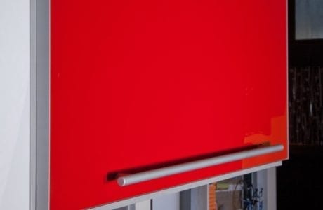 High Gloss Red Cabinet Door With Metal Trim and Handle