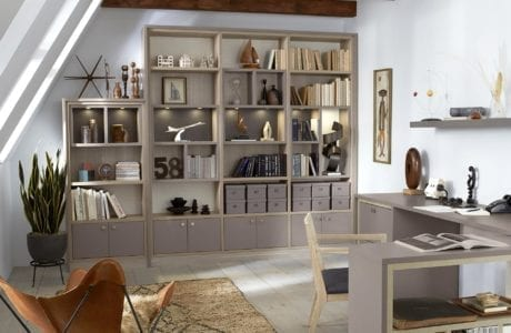 Light Grey Themed Office With Shelving Cabinets Built In lighting L Shaped Desk and Light Wood Highlights