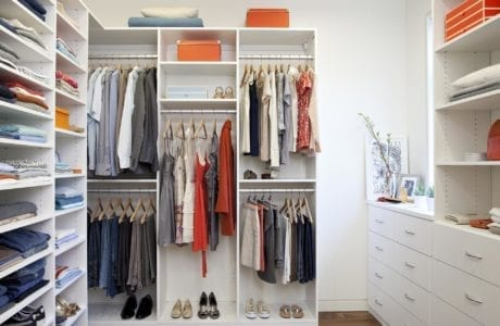 White Walk in Closet with Shelves Drawers and Metal Closet Rods