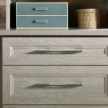 Close Up of Storage Cabinet with Light Grey Wood Grain Drawers and Shelving