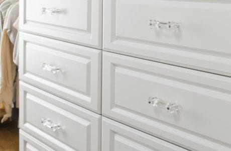 Close Up of White Dresser Drawers with Clear Handles