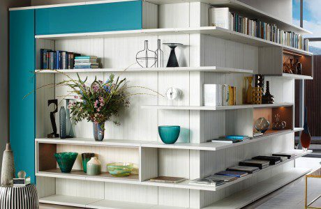 Light Grey Shelving with Lighted Display Shelves and Turquoise Fronted Cabinets