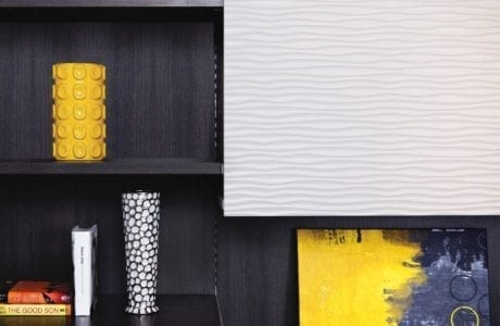Close Up Black Shelves with White Textured Cabinet Door