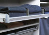 California Closets TAG hardware divided shelf with folded jeans in gray metal finish