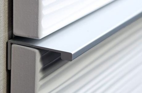 Close up of steel drawer hardware integrated in a hidden hardware system