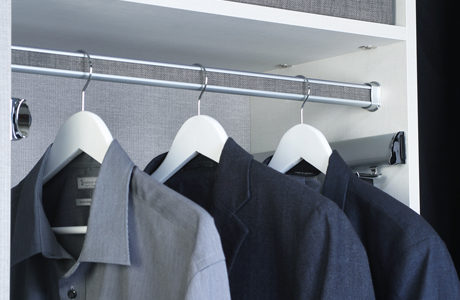 California Closets TAG hardware close up of hanger pole with fabric inserts and steel accents