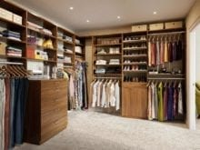 Light Brown Wood Grain Addison Walk in Closet With Shelves Shoe Racks Drawers and Metal Closet Rods