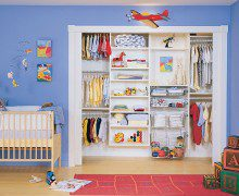 Children's White Reach in Closet with Shelving and Built in Metal Baskets and Closet Rods