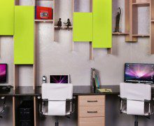 Office Space With Hanging Light Wood Shelving and Drawers High Gloss Black Desk Tops and Lime Green Accent Panels