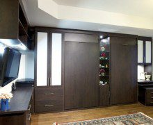 Set of Dark Brown Murphy Beds with Built in Shelving Drawers Counter Tops and Cabinets with White Inlay Accent Panels