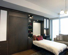 Dark Brown Murphy Bed with Built in Shelving Drawers and Cabinets with White Inlay Accent Panels