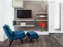 Entertainment Center With High Gloss Grey Backing Light Grey Floating Cabinets and Shelves and Texture Accent Panels