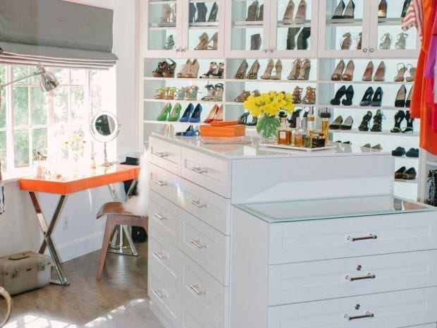 Walk in Closet with High Gloss White Cabinets Stand Alone Dresser and Orange Vanity Desk