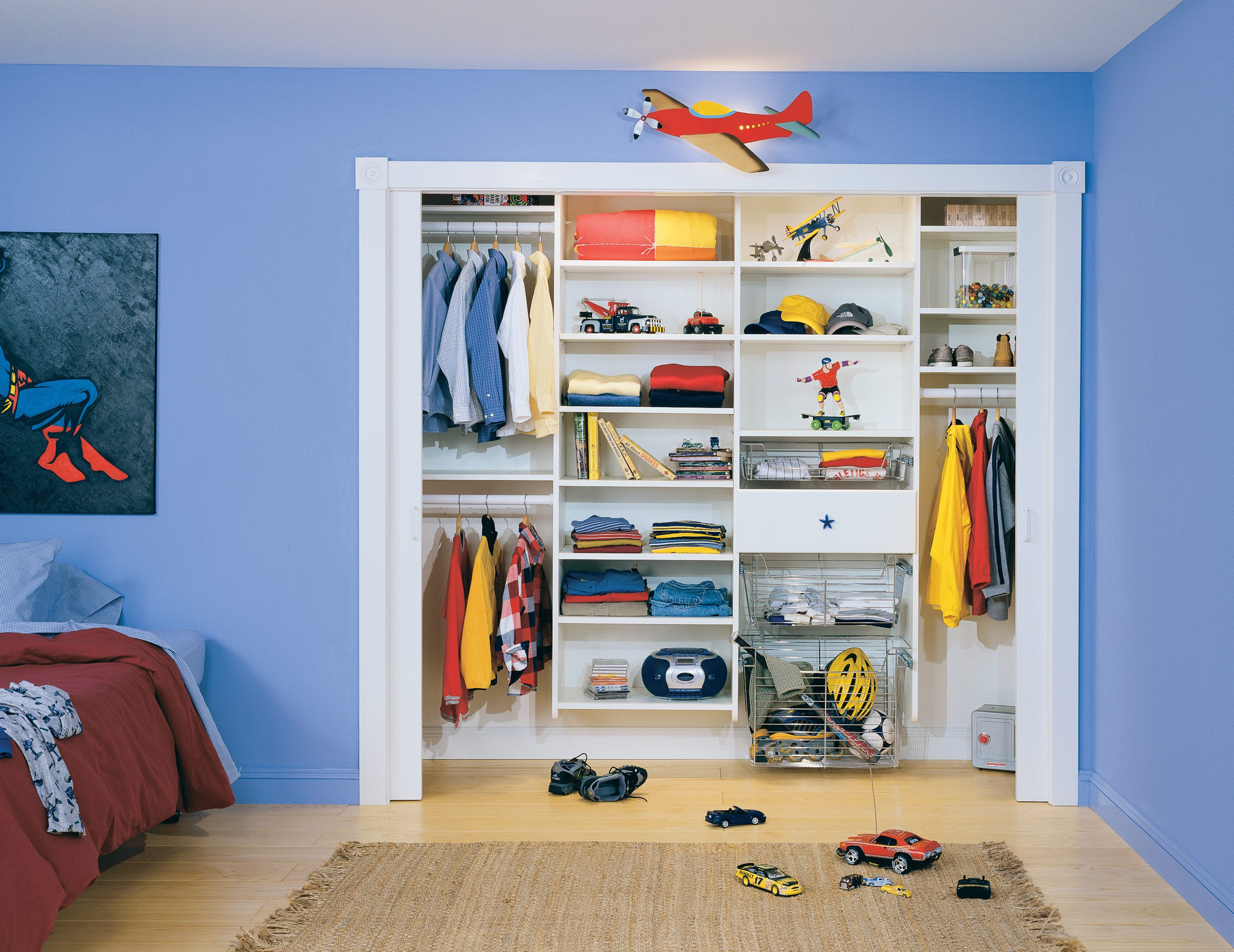 Childrens reach in closet with white shelving metal closet rods and slide out metal baskets