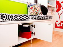 White High Gloss Craft Room Built in Seating With Black and White Top Cushion and Cabinet Storage