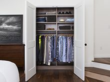 Erica Coffman Client Story Dark Brown Reach in Closet Shelving And Hanging Clothes