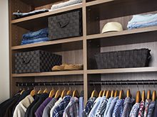 Erica Coffman Client Story Close up of Dark Brown Reach in Closet Shelving And Hanging Clothes