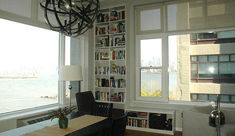 Built In White Book Shelf in Near Apartment Bay Windows