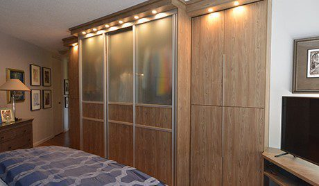 Light Wood Wardrobe with Frosted Glass Half Doors and Metal Accents