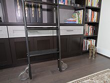 Close Up of Sliding Black Library Ladder and High Gloss White Accent Drawers