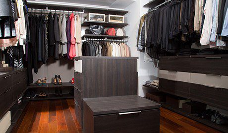 Dark Brown Walk in Closet with Shelving Closet Rods Floor Level Cubbies and Stand Alone Tiered Dresser