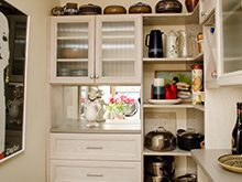 White Wood Grain Pantry With Drawers Shelving Cubbies and Etched Glass Cabinet Doors