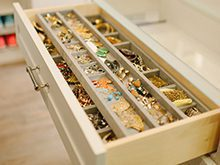 Close Up of Light wood Dresser Drawer with Jewelry Organizers