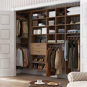 Dark Wood Reach in Closet with Closet Rods and Light Brown Drawers and Shelving