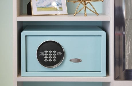 Close up of White Cubbie Shelvines with Built in Turquoise Safe