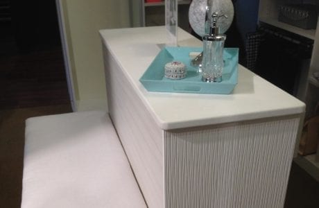 CLose up of White Walk in Closet Bench Seating with Display Counter Top