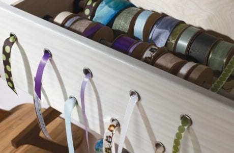 Close up of White Wood Grain Ribbon Storage Drawer with Pull Through Holes