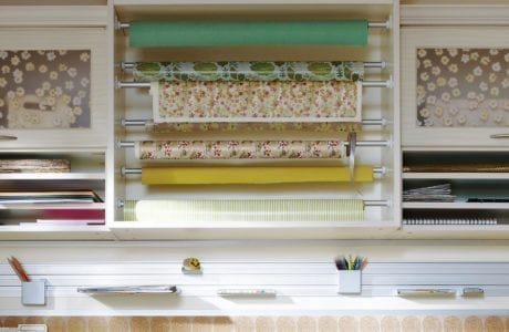 Close Up of Craft Room Storage with Shelving Wrapping Paper Rods and Metal Sliding Rack for Art Supplies