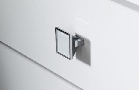 Close Up Image of White Wood Grain Dresser Drawer with Metal Roofgarden Drawer Knob
