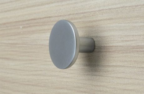 Close Up Image of Natural Wood Grain Dresser Drawer with Chrome Drawer Knob