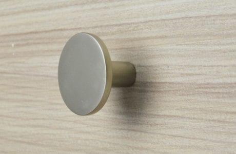 Close Up Image of Natural Wood Grain Dresser Drawer with Matte Aluminum Drawer Knob