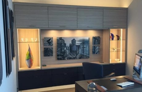 Grey Wood Grain Office Space Storage with Display Shelves Built in Lighting and Black Accent Cabinets