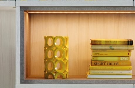 Close Up of White Book Shelf Cubbie With Built in Lighting and Grey Trim